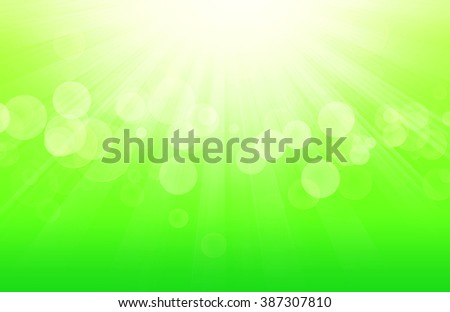 Green spring background with sunrays and blurs