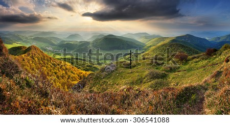 Green Spring Slovakia mountain nature landscape with sun and cross - stock photo