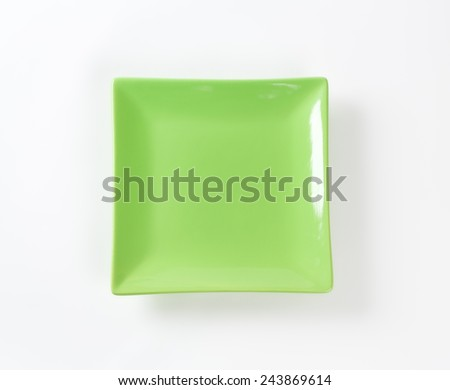 green square plate on white background