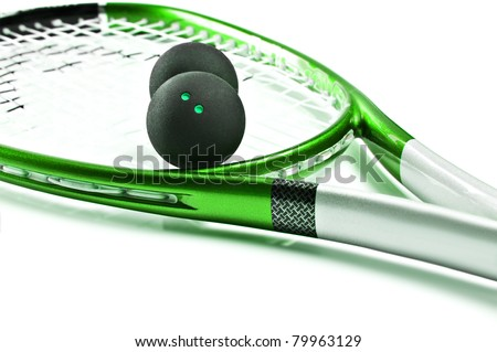 Green squash racket with balls on white background with space for text - stock photo