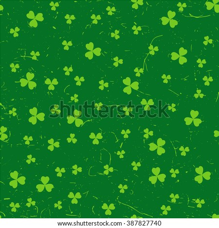 Green St. Patrick's day pattern with clover leaves over grunge background. - stock photo