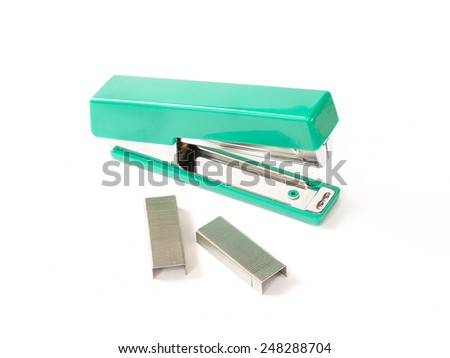 Green Stapler with staples wires on white background. - stock photo