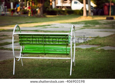 green steel relax chair in park