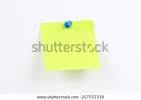 Green sticker on a white message board - stock photo