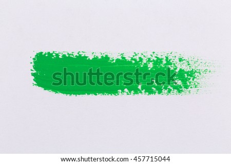 green stroke of the paint brush on white paper - stock photo