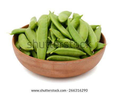 green sugar snap peas in bowl isolated on white  - stock photo