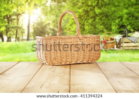 green sunny day in park and empty basket