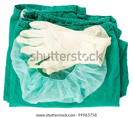 Green surgical clothing and sterile gloves over a white background - stock photo