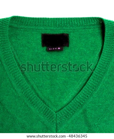 green sweater with empty label