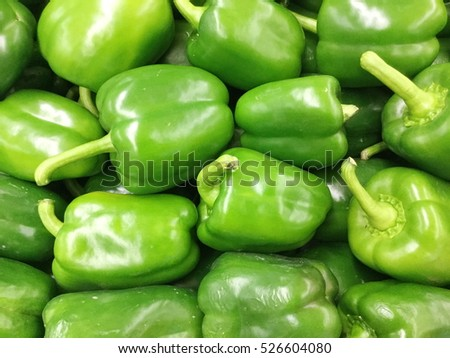 Green Sweet peppers on the shelves in supermarkets.