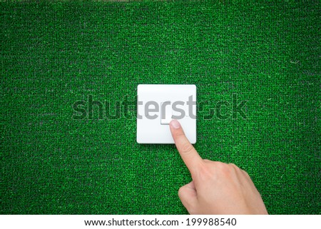 Green switch with human hand, eco renewable save energy power - stock photo