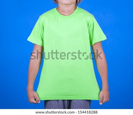 green T-shirt on a cute boy - stock photo