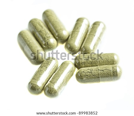 green tablets isolated on a white background