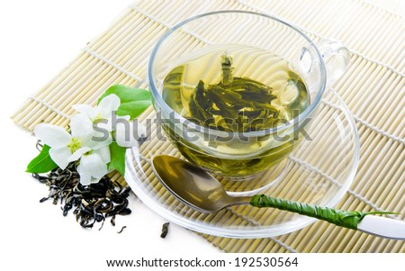 Green tea and jasmine flowers - stock photo
