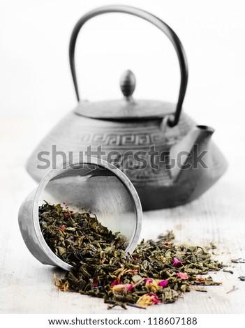 Green tea and teapot - stock photo