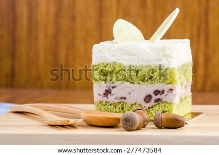 Green tea cake on wooden background, tasty cake. - stock photo