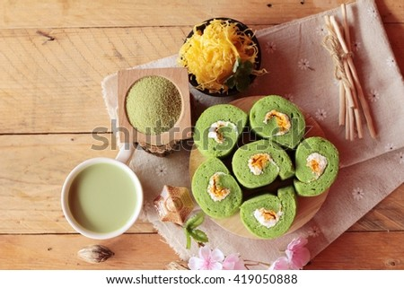 Green tea cake roll and matcha green tea - stock photo