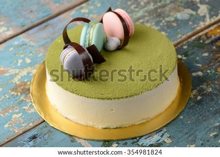 Green tea cheese cake with macaroon  - stock photo