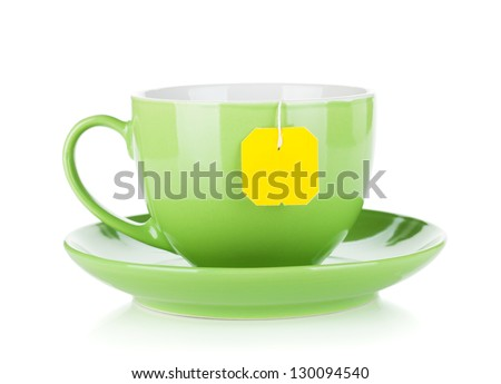 Green tea cup and teabag. Isolated on white background - stock photo