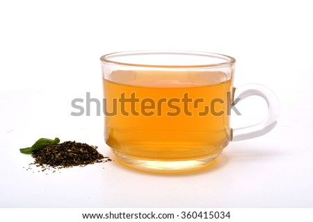 Green Tea cup with pile on white background