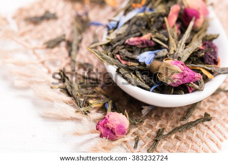 green tea, dried leaves, on wooden background.healthy drink - stock photo