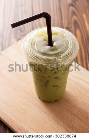 Green tea frappe in plastic cup. - stock photo