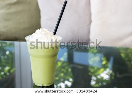 Green tea frappe with whipped cream in take a way cup - stock photo