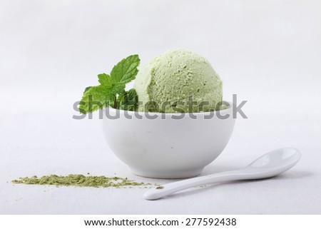 green tea ice cream in white remekin - stock photo