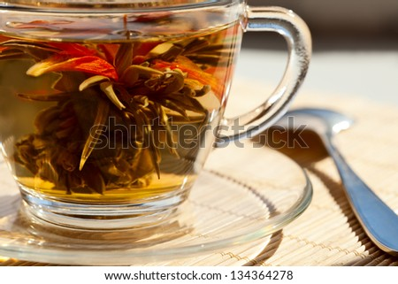 Green tea in a glass transparent mug