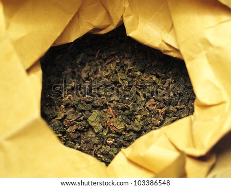 Green tea in a package - stock photo