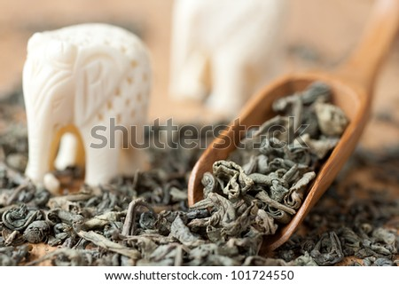 Green tea in a wooden spoon - stock photo