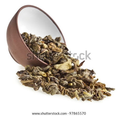Green tea in clay teacup isolated on white - stock photo