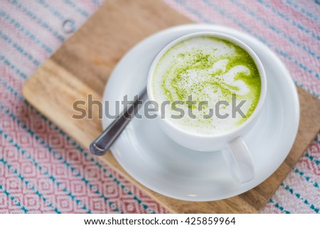 green tea latte  - matcha green tea on table background, selective focus. - stock photo