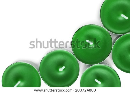 Green tea lights over white as a background