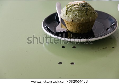 Green tea muffins on table. - stock photo