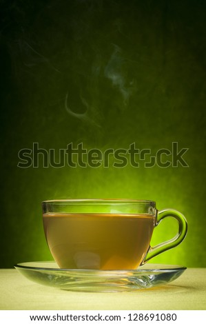 Green tea on a green background - stock photo