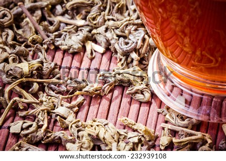 Green tea on bamboo mat. - stock photo