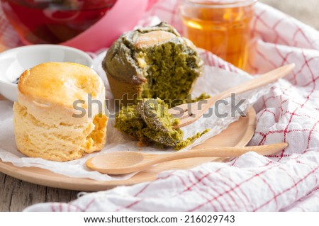 Green tea scone for tea time on wood table.