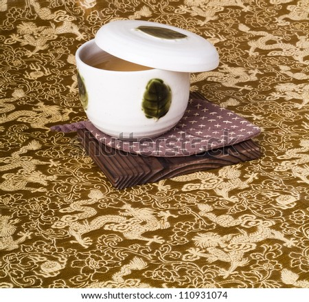 green tea set with background