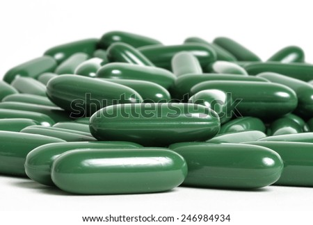 Green tea supplements up close - stock photo