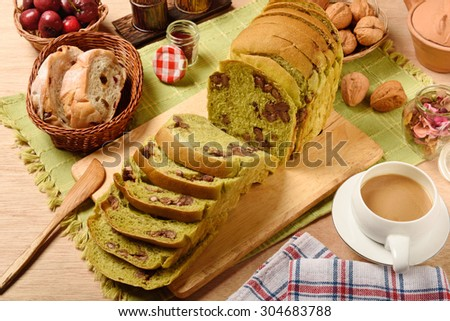 Green tea  toast with  red beans on wooden cutting board  - stock photo
