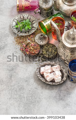 Green tea with herbs and spices. Oriental dishes and decorations - stock photo