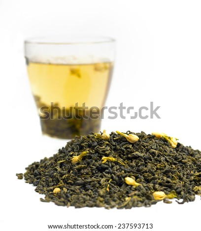 green tea with jasmine and cup in the background, close-up