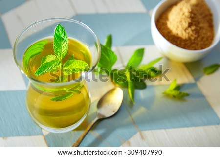 green tea with mint Moroccan style on wood blue white table