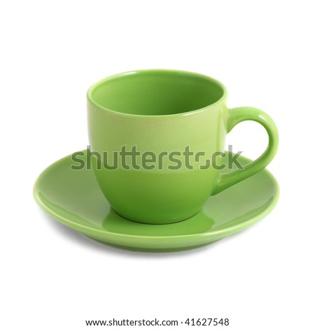 Green teacup and saucer isolated on white