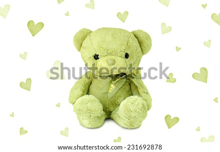 Green teddy bear with green hearts - stock photo