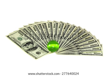 """Green temptation. The ball from the mineral """"cat's eye"""" and stack of dollar bills on white background - stock photo"""