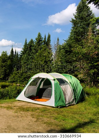 Green tent in Algonquin Park - stock photo
