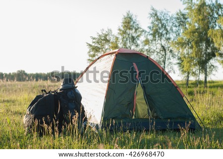 Green tent on a meadow - stock photo