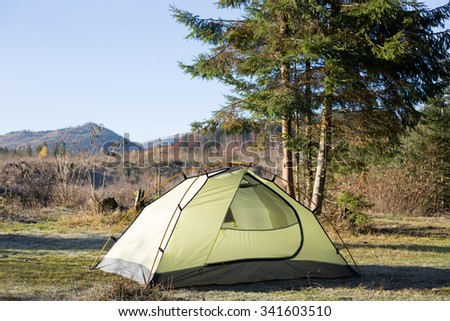 Green tent on mountain top, Retezat mountains, Romania - stock photo